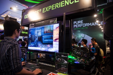 indo: Jakarta, Indonesia, 8th September 2013: Visitors experiencing latest GPU technologies from Nvidia in Indo Game Show 2013 event in Jakarta Convention Center, Jakarta, Indonesia. Nvidia is one of the major players in PC video game GPU market in Indonesia.