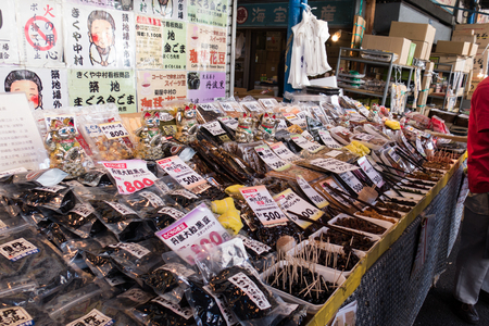 fish market: Tsukiji Fish Market, Tokyo, Japan - 31st March 2016: Fishery products on sale in Tsukiji Fish Market, Tokyo, Japan. Tsukiji Fish Market  is the biggest wholesale fish and seafood market in the world and also one of the largest wholesale food markets of an