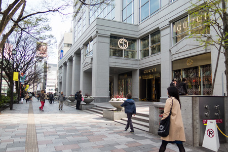 gucci store: Shinjuku, Tokyo, Japan - 31 March 2016: Pedestrian avenue and Gucci outlet store in Shinjuku shopping center, Tokyo, Japan.
