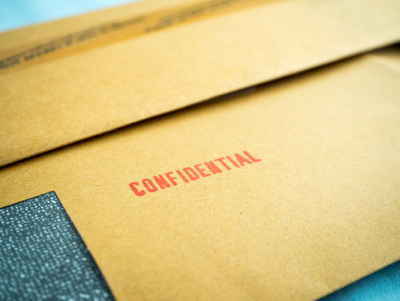 confidentiality: Confidential printed on brown vintage envelope, in macro
