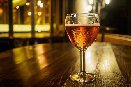 unbottled: Vintage glass of light beer on a pub restaurant Stock Photo