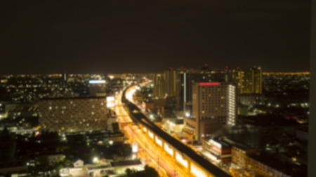complicated journey: Blurred road and city at night, traffic lights in motion blur on U-turn road