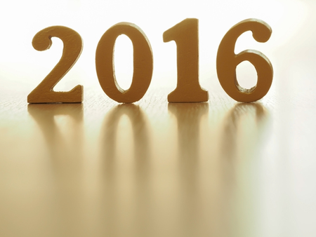 numbers abstract: Text of gold 2016, make from wood. Golden year 2016. New year decoration, closeup on 2016 text. Happy new year 2016. Gold 2016 on wood floor with copy space at the bottom for your text.