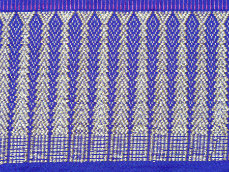 thai silk: Blue and white color of thai silk handcraft surface. Detail pattern textiles stripe beautiful background tapestry fabric fashionable textile. Use for clothes. Stock Photo