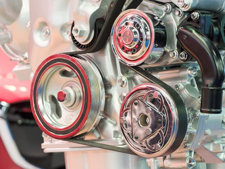 compression  ring: Closeup of modern automobile motor car engine part focus on pulley with belt. Stock Photo