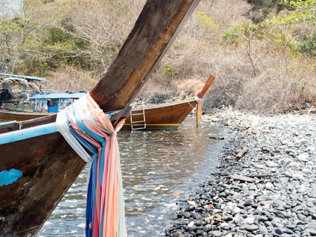 prow: Prow of local traditional long tail boat tied with fabric three colors. Stock Photo