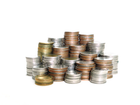 Stack of various Thai baht coins isolated on white background. Saving money, growth money concept. (selective focus)