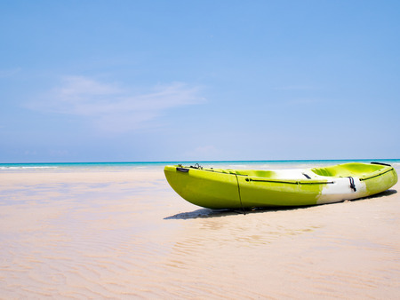 cayak: Green Kayak boat on the tropical beach background and clear blue sky at sea. Happy summer holiday concept