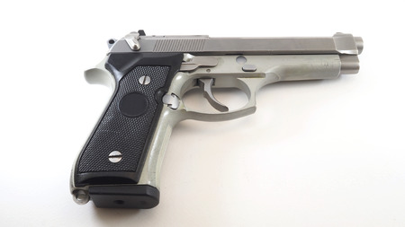 Short silver gun 11mm on white background. Stock Photo