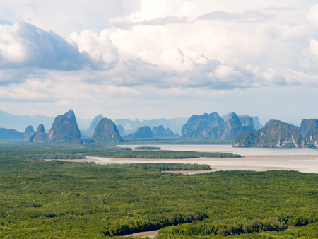 Landscape abundant nature tropical mangrove forest (intertidal forest) around limestone karst mountain sea blue sky white cloud. Nature conservation. Samet Nangshe viewpoint unseen Phang Nga Thailand Stock Photo