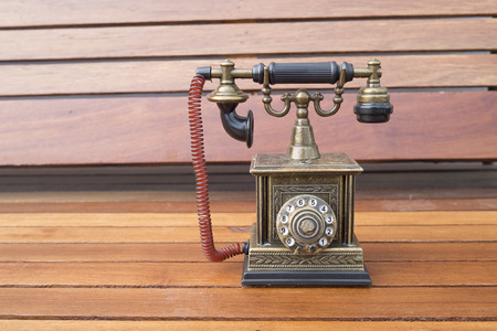 Lighter in retro classic phone model, vintage old dial Telephone on wood background