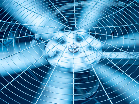 Blue tone of HVAC (Heating, Ventilation and Air Conditioning) spining blades / Closeup of ventilator / Industrial ventilation fan background / Air Conditioner Ventilation Fan / Ventilation system Stock Photo - 83794033