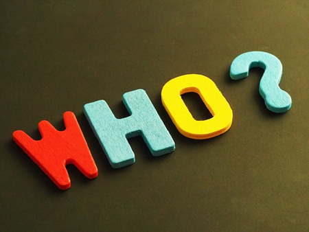 Who word from wood. Colorful of wooden Who question mark on black background.