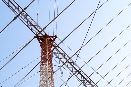 Telecommunication mast TV antennas with blue sky. High transmitter tower. Stock Photo