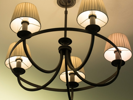 Beautiful retro luxury vintage chandelier hanging from ceiling. Classic lamp lighting. Stock Photo