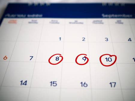 Red circle marked on three days calendar for reminder or remember important appointment.