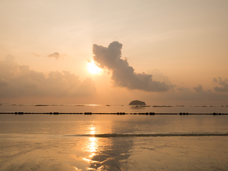 Sunrise at sea orange sky sun and cloud reflect with sea. Peaceful and relax feeling at tropical sea.
