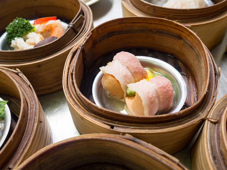 Yumcha or Dimsum, various chinese steamed dumpling in bamboo basket steamer in chinese restaurant.