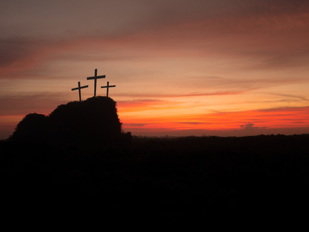 Silhouette of three crosses on hill at sunset. Religion Crucifixion Of Jesus Christ.