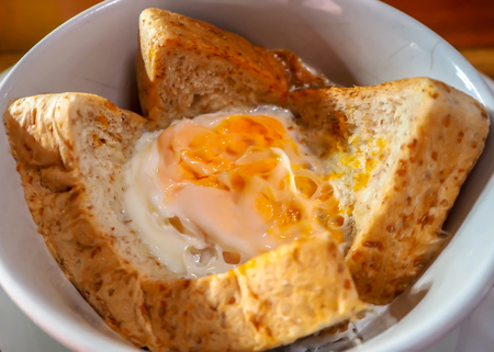 Egg baked with bread. Easy menu for breakfast in rush hour.