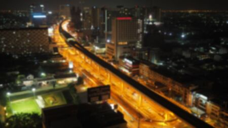 Blur top view of city night life road and sky train.