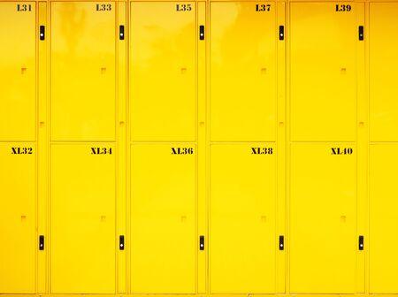 close up on yellow lockers door at public locker service at Bangkok.