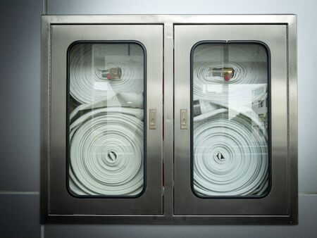 Indoor fire hose cabinet for fire extinguisher in skytrain. Safety first concept.
