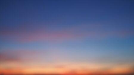 Blur background sky of atmosphere evening sunset. Dramatic skyline with dark blue sky and orange.