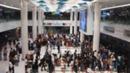 Blur people queue in terminal departure check-in at airport for fly flight.
