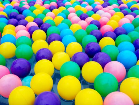 colorful of balls floating in pool for children in water park. Reklamní fotografie