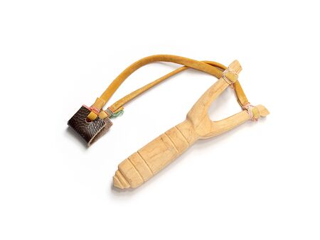 Handmade slingshot catapult. Y-shaped wooden stick with elastic tied between two top parts. Slingshot or Catapult is device for shooting small stones.