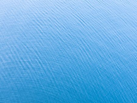 Unique blue background. Abstract blue ripple background for backdrop or wallpaper.