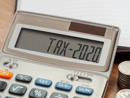 Tax word and 2020 number on calculator. Business and tax concept. Pay tax in 2020 years. Reklamní fotografie