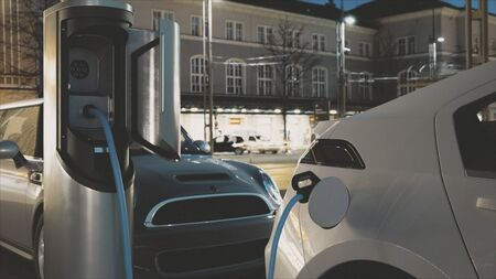 Electric Car Charging At A Charging Station (evening version, v1) Stockfoto