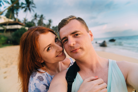 happy lovers take pictures of themselves on the beach Stock Photo