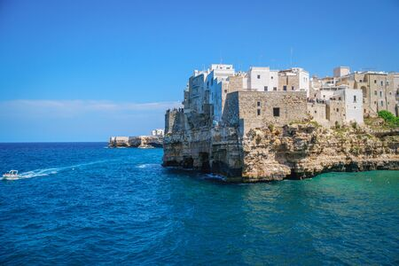 Coast of Polignano a Mare on sunny summer day, view from sea