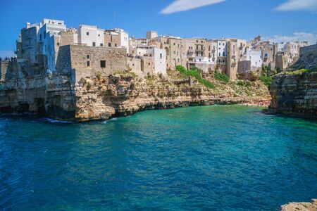 View of sea from Polignano a Mare and beach with tourists, Puglia, Italy