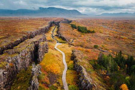 Autumn landscape in Iceland, rocky canyon on background of mountain, drone shot Banque d'images - 133676340