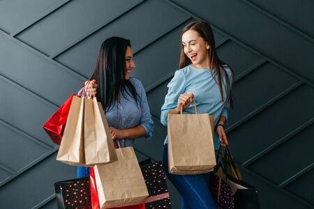 Two happy girlfriends rejoice over their purchases, black Friday concept Banque d'images - 133678245