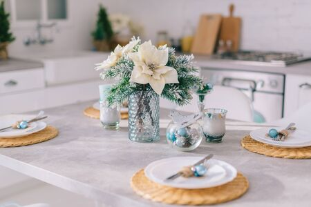 Close-up, festive Christmas table setting in a bright cozy kitchen