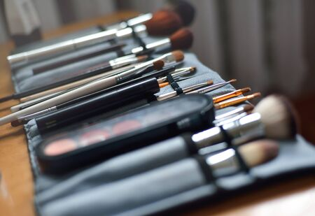 Closeup of makeup tools in their holder, selective focus.