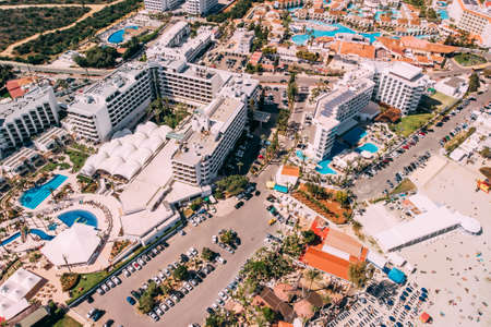 View of luxury hotels and villas with pool in Ayia Napa, Cyprus, drone shot Stok Fotoğraf