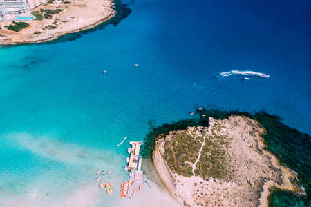 Beautiful beach on Mediterranean Sea with many tourists on sunny day, aerial
