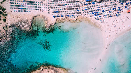 Beautiful beach on Mediterranean Sea with many tourists on sunny day, drone shot