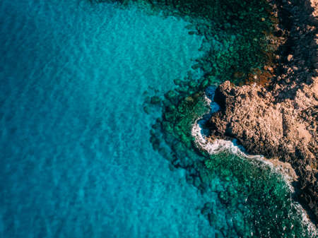Aerial Rocky seashore with crystal clear blue water near Cape Cavo Greco, Cyprus Stok Fotoğraf