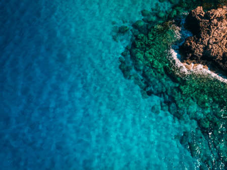 Overhead Rocky sea shore with crystal clear blue water, Cyprus Stok Fotoğraf