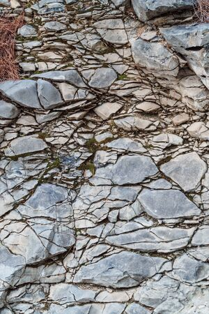 Texture of gray granite cracked wall. Close up. Imagens