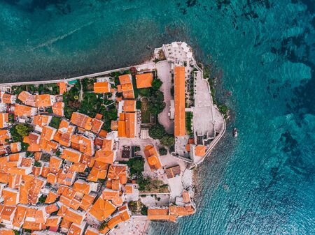 A fragment of an ancient Mediterranean city aerial view on a sunny day. Budva, Montenegro.