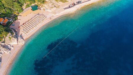 Beautiful beach with crystal clear water in the Mediterranean. Aerial view. Sunny day.