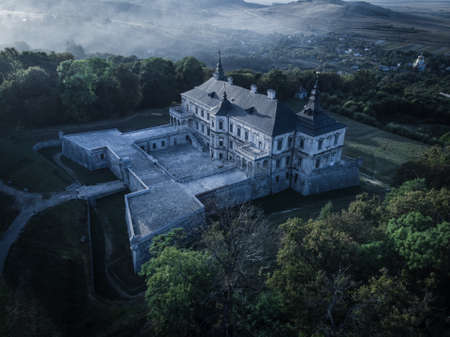 Old mystical castle in the moonlight. Aerial view.